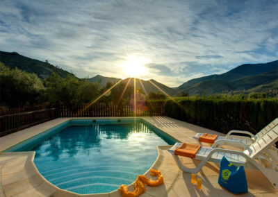 Enjoy superb sunsets from the swimming pool at Casa El Valle, Órgiva