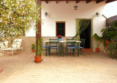 The front patio & alfresco dining area at Casa La Palmera, Arroyo Coche