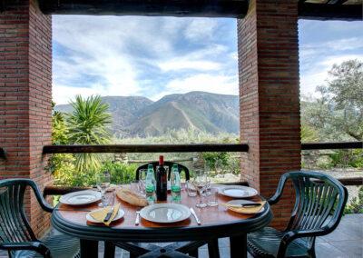 The balcony & alfresco dining area at Cortijo Las Gallinas, Órgiva