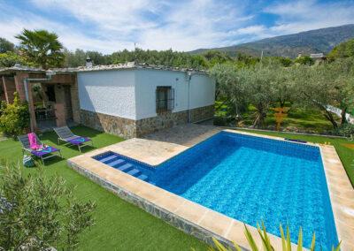 The swimming pool & garden at Cortijo Las Gallinas, Órgiva