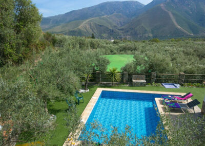 Cortijo Las Gallinas, Orgiva is a two bedroom house filled with Andalucian character & comfortable furnishings. Outdoors there's a shady terrace, garden & olives trees around the private pool. Close to village bars & market with superb mountain views.