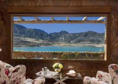 Enjoy lake vistas through the living area's large picture windows at El Dolmen de Alaju, El Gastor