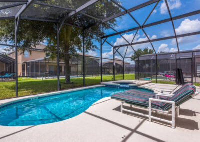 The swimming pool & spillover tub at Emerald Island Resort 25, Kissimmee, Orlando