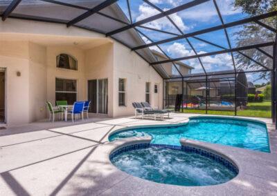 The covered lanai, spillover tub & swimming pool at Emerald Island Resort 25, Kissimmee, Orlando
