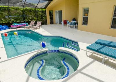 The covered lanai, swimming pool & spillover tub at Emerald Island Resort 58, Kissimmee, Orlando