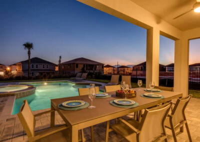 The alfresco dining area & swimming pool at Encore Resort 394, Kissimmee