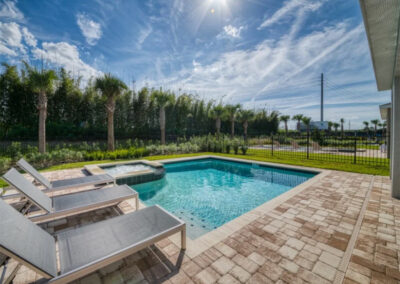 The spillover tub & swimming pool at Encore Resort 550, Kissimmee