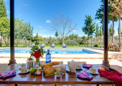 The covered patio & alfresco dining area at Hacienda Los Olivos, Ronda