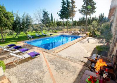 The barbecue area & swimming pool at Hacienda Los Olivos, Ronda