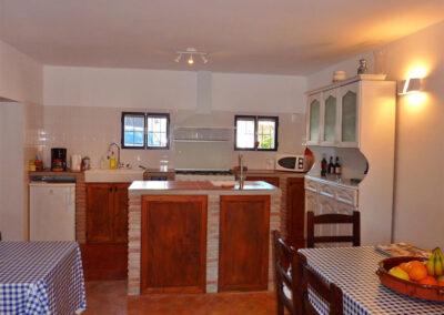 The kitchen & dining area of villa #2 at La Abadesa, Nueva Andalucía