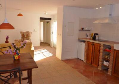 The kitchen, dining & living area of villa #3 at La Abadesa, Nueva Andalucía