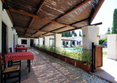 The shady walkway connecting the bedrooms at La Abadesa, Nueva Andalucía