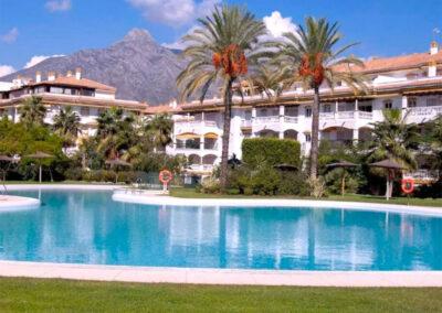 The resort swimming pool at La Dama De Noche, Nueva Andalucía
