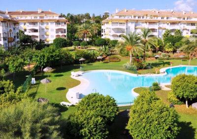 The resort swimming pool & gardens at La Dama De Noche, Nueva Andalucía