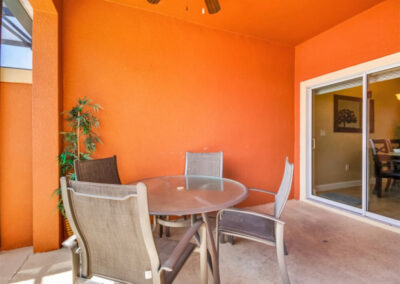 The covered lanai & alfresco dining area at Paradise Palms Resort 10, Kissimmee