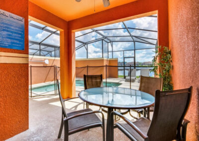 The covered lanai, alfresco dining area & swimming pool at Paradise Palms Resort 10, Kissimmee