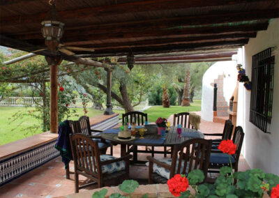The covered dining terrace at Sierravista, Órgiva