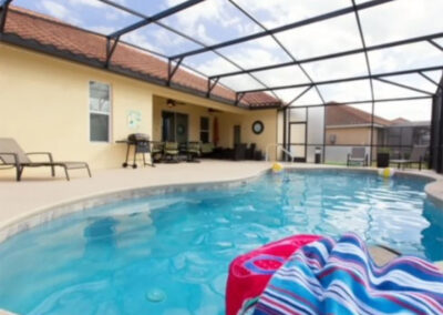 Solterra Resort 131, Davenport is a spacious four bedroom, three bathroom home with screened private pool, games room with pool table & video games. Two living area provide ample space for eight guests. Onsite water park, restaurant & tennis just 15 minutes from Disney.
