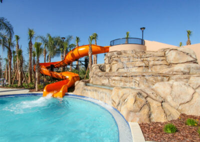 The resort swimming pool & water slide at Solterra Resort, Davenport