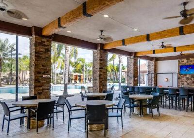 Enjoy cocktails in the poolside bar at Solterra Resort, Davenport, Orlando