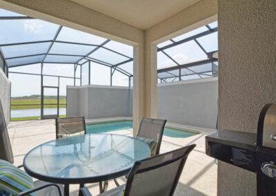 The covered lanai, outdoor dining & barbecue area at Storey Lake Resort 66, Kissimmee, Orlando