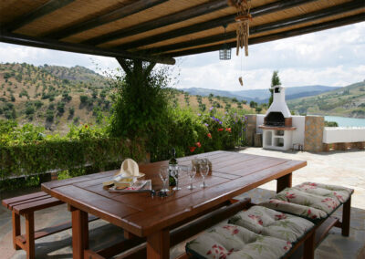 The covered patio, alfresco dining & barbecue area at Villa Alaju, El Gastor