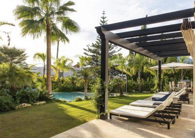 The sun loungers & swimming pool at Villa Alandalus, Nueva Andalucía
