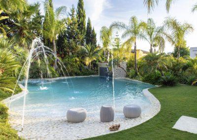 The zero-entry lagoon pool & hidden jacuzzi at Villa Alandalus, Nueva Andalucía
