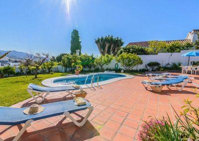 The patio & swimming pool at Villa Angelinas, Nerja