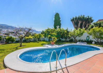 The swimming pool & garden at Villa Angelinas, Nerja