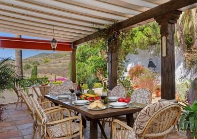 The outdoor dining area at Villa Casanova, Nerja