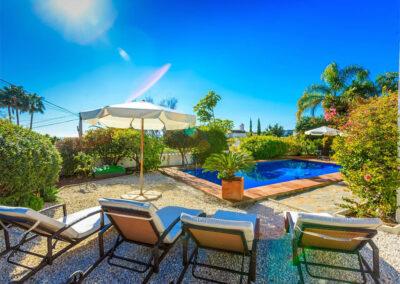 The gravelled garden & swimming pool at Villa Rucula, Estepona