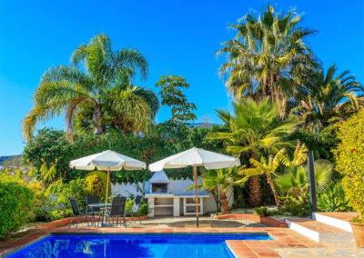 The swimming pool, patio & barbecue area at Villa Rucula, Estepona