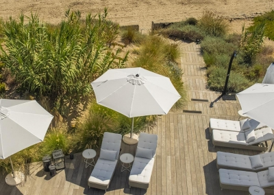 The decked patio at Villa Sequillo, Costabella leads down to the beach