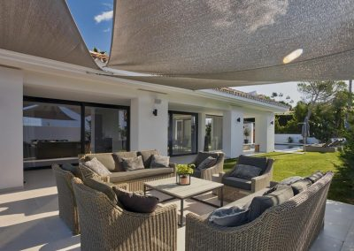 The outdoor living area at Villa Tucan, Nueva Andalucía