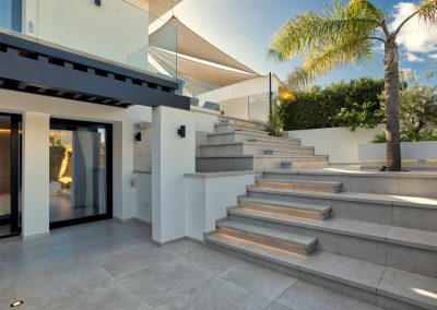 Stairs leading up to the ground floor patio & swimming pool at Villa Tucan, Nueva Andalucía