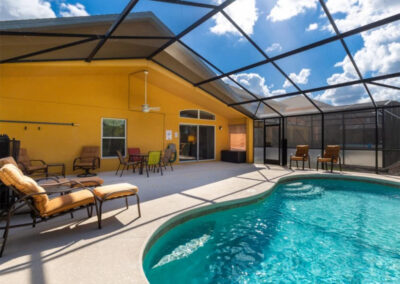 The alfresco dining area & swimming pool at Watersong Resort 50, Davenport