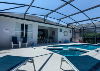 The patio, spillover tub & swimming pool at Windsor Palms Resort 21, Kissimmee, Orlando