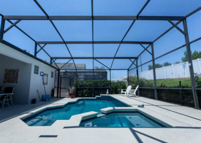 The patio, swimming pool & spillover tub at Windsor Palms Resort 21, Kissimmee, Orlando